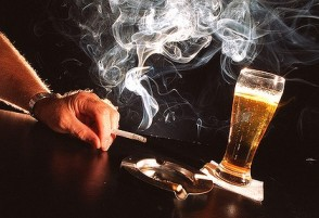 Alcoholics -- drunk or sober -- smoke at three times the rate of the general population